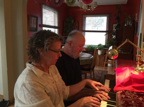 Christina & Ken four-handing it on the family baby grand! piano.