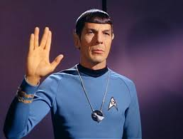 Mr. Spock wearing the Vulcan I.D.I.C. and performing the Vulcan salute.